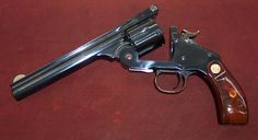 Schofield top-break revolver (competitor to the Colt Peacemaker, which required a much slower reload.) A .45 Smith & Wesson revolver.: