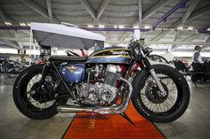 Honda-cb-750-cafe-racer-shaved-tail-cool-under-stainless-steel-4-into-1-exhaust-system-chromed-engine-crankcases-and-forks