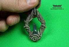 Pendant made of wire with a crystal of quartz.
