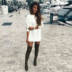 So cute. Oversized cream sweater dress + long black boots #casual #winter #fall #streetstyle