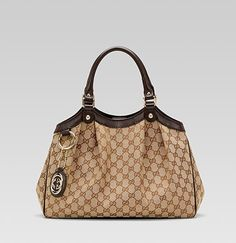 Gucci Bag...Classic and simple. This should be carried on day cruises and to nail appointments. Anything else would be presumptuous.