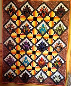 """Art Deco Quilted Wall Hanging. Modern Dresden Blocks combined with Cleopatra's Fans. 67"""" x 85"""" quilt."""
