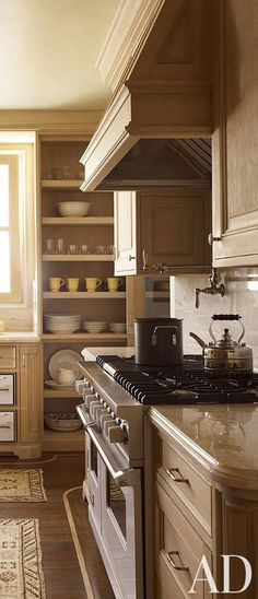 Beautiful warm kitchen designed by Tucker Marks.