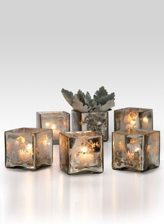 THE FINISH ON THESE GLASS Cubes RESEMBLES ANTIQUE MERCURY GLASS. These interesting glass votive holders will look great at a wedding reception table, or dinner table, at home or in a restaurant. YOU MUST USE A LINER IF YOU PLAN TO U
