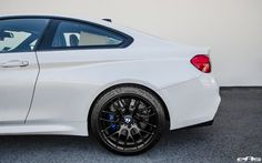 image of BMW M4 With Akrapovic Carbon Fiber And Aftermarket Wheels 3 750x469