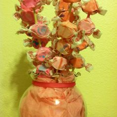 Teacher gift for valentines day on a budget! .99 cent vase, .50 for foam base, .99 for tissue paper, .50 for ribbon, and taffy $4.00 for 2 lbs (lots of extra), skewers left over from summer bbq, kids had a blast making them.