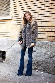 10 Ways to Wear Flares -  Notice the natrue worn detljene front tips of her shoes. Adding a touch of fur (real or fake) adds a bit of luxury to your casual flared jeans.