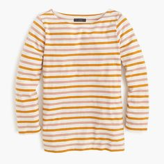 "We love striped T-shirts. Especially this one, featuring a unique navy-and-red color combo and a wider neckline. <ul><li>Slightly loose fit.</li><li>Body length: 24"".</li><li>Cotton.</li><li>Machine wash.</li><li>Import.</li></ul>"