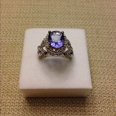 6.2ct Tanzanite Criss Cross Ring Lead Free Alloy (Brass) with White Gold Rhodium and a huge oval Tanzanite Cubic Zircon Center Stone. Ocean Jewelers Jewelry Rings