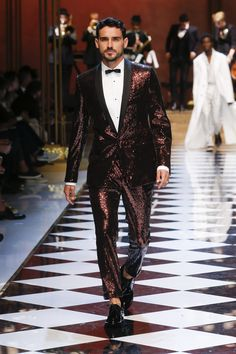 Mimetic of the Jazz Age's classic opulence, Dolce & Gabbana have favoured the deep amber golds, rich oxblood, and the perennial black suit in their 2017 summer collection. Another influence so clearly