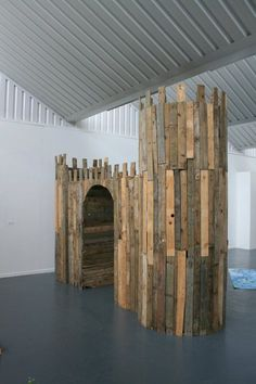 used pallets to build a castle playhouse