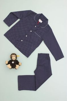 Plaza, 100% Pure Cotton Batiste Kids Pajamas. The Plaza is a classic Derek Rose pajama. a navy and white polka...