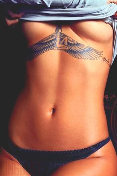 Rihanna's Tattoo Under Breast