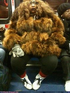 Sasquatch or Chewbacca? Fur Coat Fashion Fail: I can't tell whether this is chewbacca or sasquatch but I do know that this coat is the ugliest I've ever seen. Moda Fail, Poorly Dressed, Fur Coat Fashion, Pedobear, Say Something Nice, People Of Walmart, 1 Gif, Fashion Fail, Bad Fashion