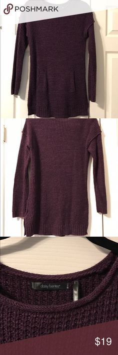 Daisy Fuentes M long purple knitted sweater Daisy Fuentes size Medium, long eggplant purple knitted sweater with front pocket. Perfect to pair with leggings and boots. 89% acrylic, 11% cotton. Gently used, from a smoke and pet free home. Please ask any questions and thanks for visiting my store! Daisy Fuentes Sweaters Crew & Scoop Necks