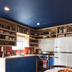 """Sofie Howard bought a one-bedroom, 500-square-foot trailer in Malibu and called in her colleague Steven Johanknecht, a principal at the design firm Commune, the L.A. design collective. """"'Doctor Steven' came in and worked his magic,"""" says Howard.The kitchen cabinetry echoes the new blue ceiling. The brick tile is from Heath Ceramics, as is the dinnerware. Behind the Viking stove is powder-coated corrugated metal (""""Very trailer,"""" says the designer). The refrigerator is from Big Chill. On the…"""