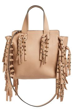 93a7681d3a04 Studded fringe leather tote by Valentino. A perfect balance of rocker-glam  and uptown luxe