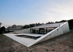 This concrete house has a triangular profile #Architecture