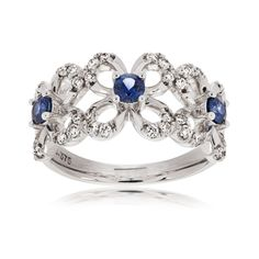This 9ct White Gold Sapphire and Diamond ring is unique in it's flower design. A real eye-catcher.
