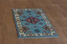 Hand Knotted Indo Kazak Rug from India. Length: 150.0cm by Width: 90.0cm. Only £164 at https://www.olneyrugs.co.uk/shop/rugs-for-sale/indian-indo-kazak-21582.html    Check out our ravishing collection of Persian and Oriental carpets, foot stools and Kilim bags at www.olneyrugs.co.uk