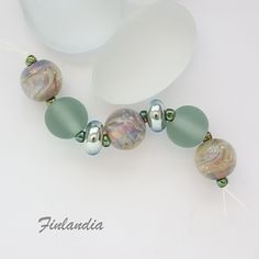A set of seven beads - five round beads and two rondelles, with silvered glass and etched glass. Glass Etching, Etched Glass, My Glass, Round Beads, Glass Beads, Pearl Earrings, Pearls, Jewelry, Artist
