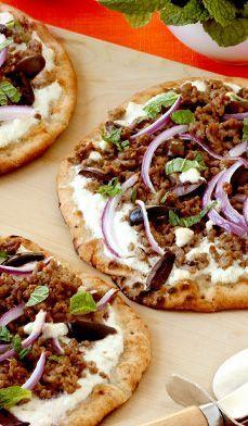 Spring Lamb Pitas - Greek flavors like mint, kalamata olives and cumin season these mini pita pizzas.