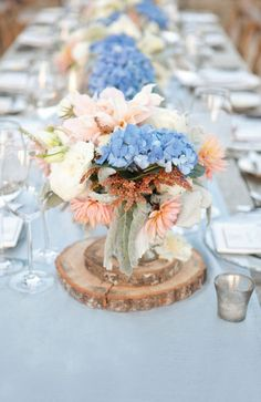 Love the wood !! It would help to add some height to the center pieces since we don't want those huge and tall type center settings.