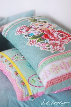 Pillows - looks like they they're made from vintage linens