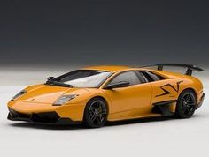 Lamborghini Murcielago SV Diecast Model Car by AUTOart 54627 This Lamborghini Murcielago SV Diecast Model Car is Atlas Orange and features working wheels. It is made by AUTOart and is scale (approx. Autoart Diecast, Lamborghini Models, Rubber Tires, Diecast Model Cars, Scale Models, Super Cars, Vans, Vehicles, Orange