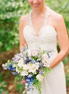 Blue, purple, green and white natural wedding bouquet | Photo: Justin DeMutiis Photography