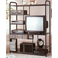 """48"""" Wide large Black metal frame entertainment center has built in CD and Movie racks and measures 48"""" x 18.5"""" x 66 """"H. Some assembly required. SKU 507A"""