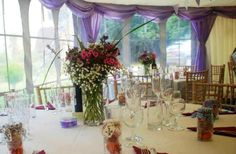 Light purple or lilac swags give a beautiful splash of colour in this pretty wedding marquee ...