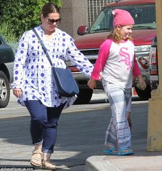 Staying close: The Bridesmaids actress, who is married to fellow actor Ben Falcone, stepped out in dark wash cropped denim Melissa Mccarthy Daughters, Celebrity Baby News, Pink Beanies, Girl Day, Big And Beautiful, Plus Size Outfits, Ben Falcone, Indigo, Street Style