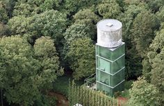 Crepain Binst Architecture built this ununsual contemporary home out of an old water tower in Antwerp, Belgium.