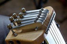 Harmos Americana Guitar neck and tuning fingers