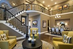 Open room with a wrap around staircase