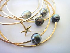 pearl bangles    Tahitian Pearl Bangle on 14k Gold Filled by erina808 on Etsy, $88.00