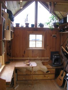WHOA. I feel like I could create SO FREELY in that space. Love the big windows/plant shelf & the great desk area. Gold Thread Tiny House