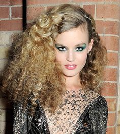 Rimmel face Georgia May Jagger stepped out with her hair styled in a massive cloud of tight ringlets, a look that, paired with her glittering embellished dress and bold green eye makeup, brought to mind the Studio 54 era.