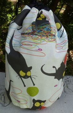Cat knitting project bag,  drawstring bag, WIP bag, happy kitty, Suebee. $17.95, via Etsy.