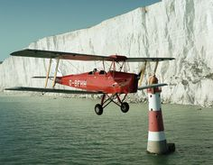 This Tiger Moth was owned by a friend and he asked me to shoot it over Beachy Head Lighthouse. I insisted that we had to be looking across at the lighthouse and the white cliffs and not down on it; this involved getting the formation down to about 100 feet over the water.