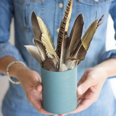 Transform soup cans into a modern feather arrangement. Check out how I used these for a Thanksgiving table in moody blues