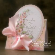 I love the die cut oval for the sentiment and then flowers to the left.  Beautiful card
