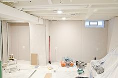 Basement painted exposed ceiling