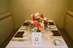 Table number and flower arrangement at Circa 1886 Restaurant wedding.