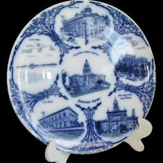 A true antique, left beautiful from years of display rather than use. This plate has a flow blue back stamp with the name Frank Beardmore & Co Fenton England which produced earthenware at the Sutherland Pottery, Fenton Stoke-on-Trent.  Frank Beardmore began potting on his own in 1901 - (although the standard references record 1903. Pottery Gazette & Journals for the time period document a 1901 start) until 1914 making this piece antique!  The company produced souvenir ware for the American…