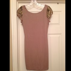 Long top with gold accessories Never Been Worn! This is a long tee or even for the right person, could be a sexy little dress. I am 5'7 and is definitely not a dress, unless you want your toosh to fall out  Forever 21 Tops Blouses
