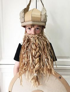 A fun DIY on how to make a cardboard viking helmet with horns.
