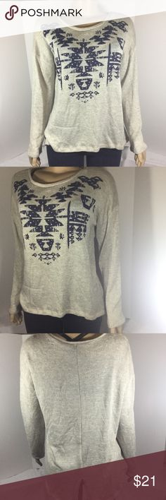 New Directions Weekend Aztec Print Taupe Sweater New Directions Weekend Aztec Print Taupe Sweater Taupe And Navy Blue color Small Silver Rhinestones on the Print  Hi-Low with middle slit in the back Excellent Used Condition  No rips, stains, or holes  59% Polyester  40% Rayon 1% Spandex  161 new directions Sweaters Crew & Scoop Necks
