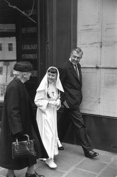 Magnum Photos -  Henri Cartier-Bresson // FRANCE. Paris. 8th arrondissement. Saint-Philippe du Roule church. 1958. The French movie director Jacques TATI with his daughter after her first communion.